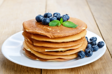Ready to eat pancakes with blueberries on the white plate photo
