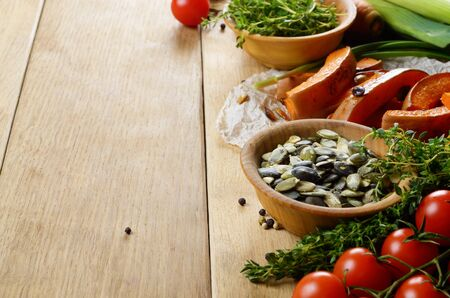 Fresh Organic Vegetables on a Wooden Background with Space For Your Text  photo