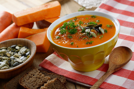 thymus: Homemade Thanksgiving Rustic Pumpkin Soup puree in ceramic Bowl Stock Photo
