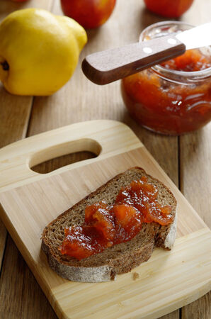jam sandwich: Bread and apple quince jam sandwich on the cut board Stock Photo