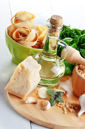 Ingredients for pasta pesto on white kitchen table photo