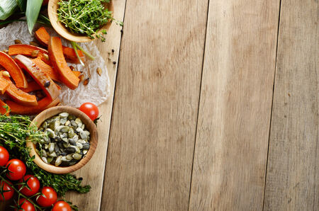 thymus: Fresh Organic Vegetables on a Wooden Background with Space For Your Text