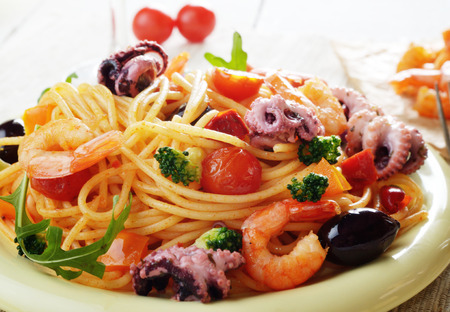 marinara: Seafood spaghetti marinara pasta dish with octopus, shrimps, cherry tomatoes and olives
