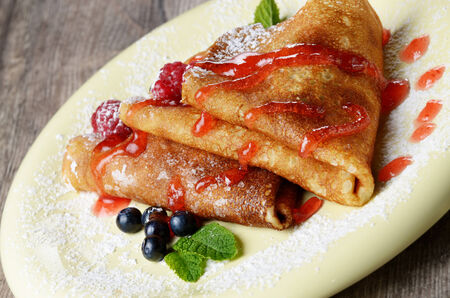 crepes: Delicious Tasty Homemade crepes with raspberries and blueberries