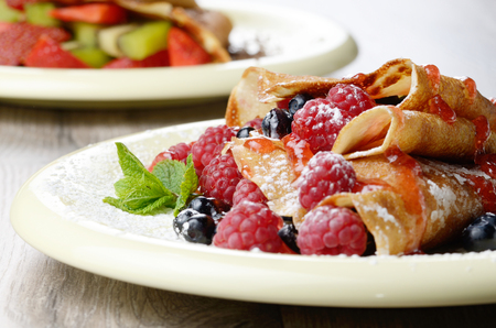 Delicious Tasty Homemade crepes with raspberries photo