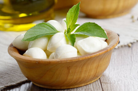 mozzarella cheese: Mozzarella cheese, cherry tomatoes, basil leaves and olive oil - for caprese salad