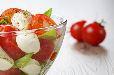 caprese salad: Homemade Caprese salad in glass bowl Stock Photo