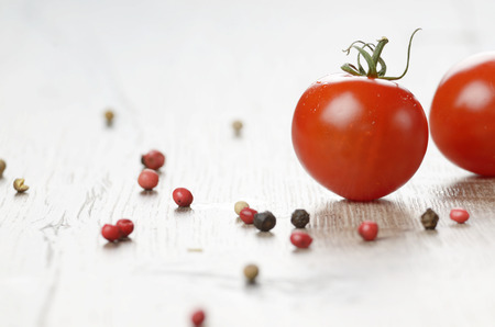 Cherry tomatoes on the wooden table photo