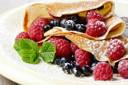 sweet foods: Delicious Tasty Homemade crepes with raspberries Stock Photo