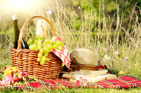 picnic cloth: Picnic basket with hat and book. Holiday vacation concept