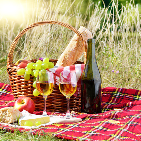 bread basket: Wine cheese bread and fruits - outdoor picnic concept Stock Photo