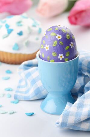 eggcup: Painted easter eggs on white table in eggcup Stock Photo