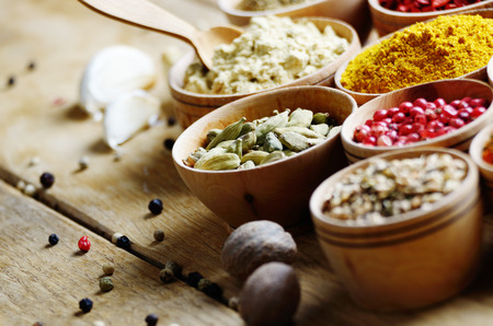 seasoning: Set of spices on wooden table