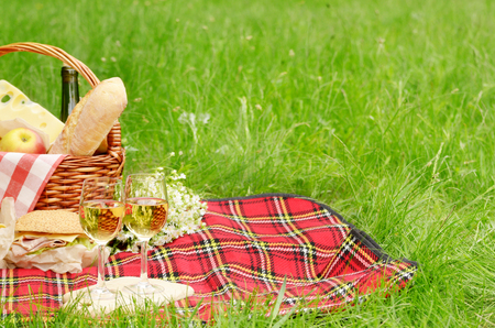 Picnic basket with apples bread cheese wine and sandwiches Stock fotó