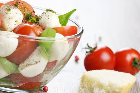 glass bowl: Homemade Caprese salad in glass bowl Stock Photo
