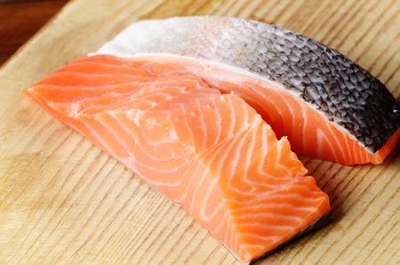 cutting board: Raw salmon fillet on cutting board