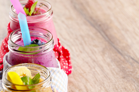 smoothie: Assorted fruit shakes on white table. Smoothie concept
