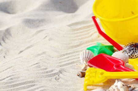 sand toys: Bright plastic sandbox toys on the sand