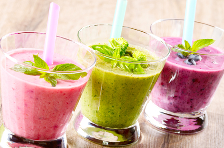 smoothie: Healthy shakes on wooden table. Smoothie concept Stock Photo