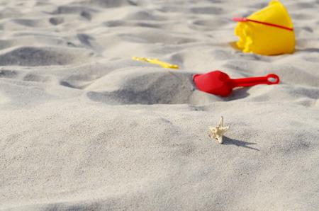 sandbox: Bright plastic sandbox toys on the sand