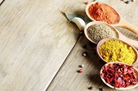 indian mustard: Wooden spoons of spices on table with copy-space