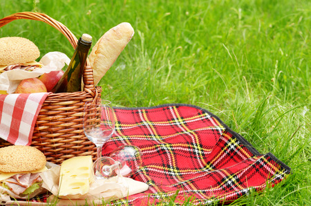 Picnic basket with apples bread cheese wine and sandwiches Reklamní fotografie