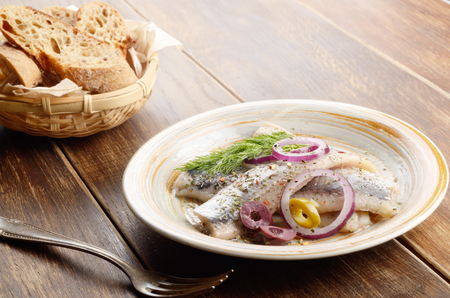kipper: Herring fillets rustic style served with olives onions and dill