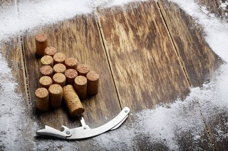 blank spaces: Christmas tree made of corks and corkscrew background on wooden table Stock Photo