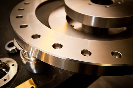 on the lathe: Custom-milled machine part made with CNC machine