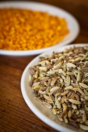 fennel seeds: Fennel seeds and dry orange rind with oranges in the background  Stock Photo