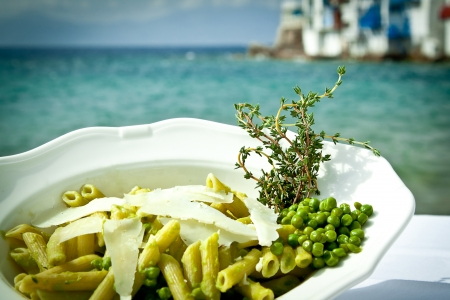 Pasta with peas and thyme by the beach, Mykonos, Greece  photo