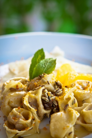 gastronomic: Tortellini with fennel, orange, mint, butter and Parmesan cheese  Stock Photo