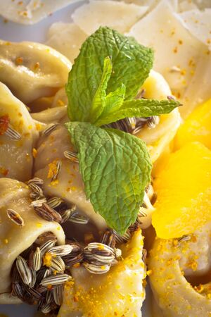 Close-up on tortellini with fennel, orange, mint, butter and Parmesan cheese  photo
