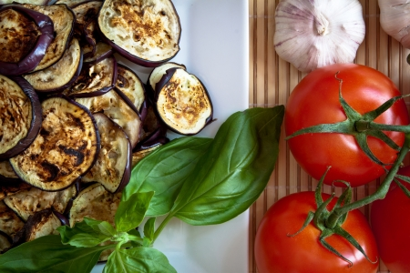 Platter of grilled aubergines with basil, garlic and tomatoes  Detail