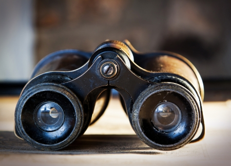 antique binoculars: Detail of vintage binoculars resting on a map