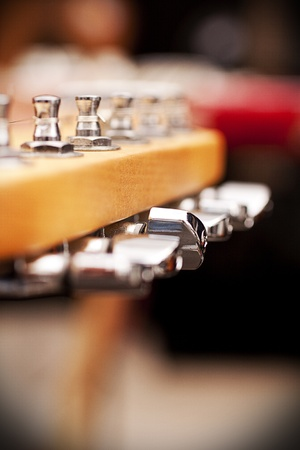 frets: Electric guitar pegbox, with selective focus on the central peg  Stock Photo