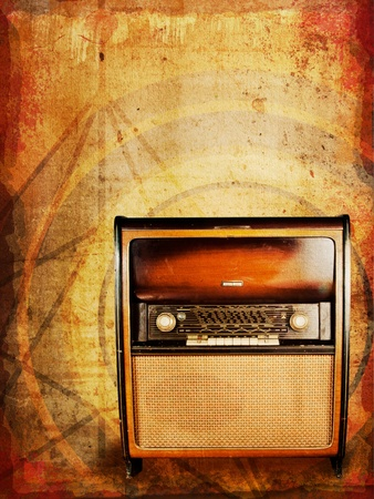 Old vintage radio, an original from the 1950s, against distressed abstract background   Stock Photo - 13884596