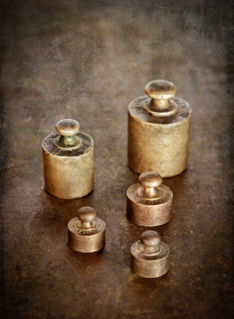 Vintage brass weights  Distressed texture for a retro feel   photo