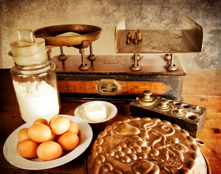 machine made: Vintage scales with all ingredients for a good cake  Stock Photo