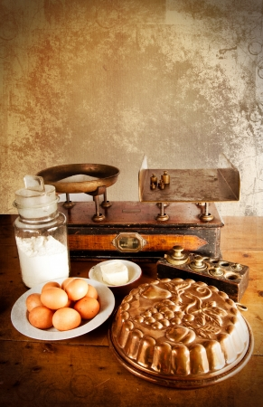 Vintage scales with all ingredients for a good cake  eggs, flour, sugar, butter  photo