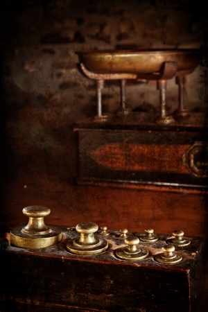 approximate: Antique brass weights with scales in the background  Distressed texture for a retro feel