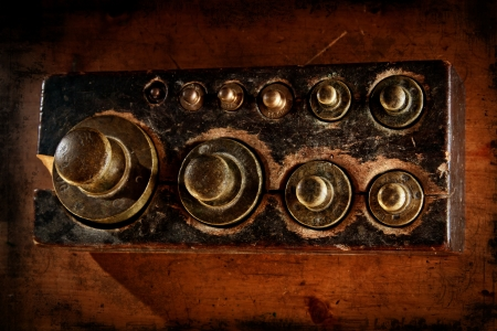 Antique scales brass weights seen from above  Distressed texture for a retro feel  photo