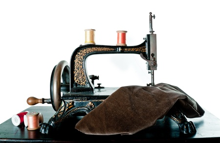 bespoke: Very old sewing machine isolated against white background