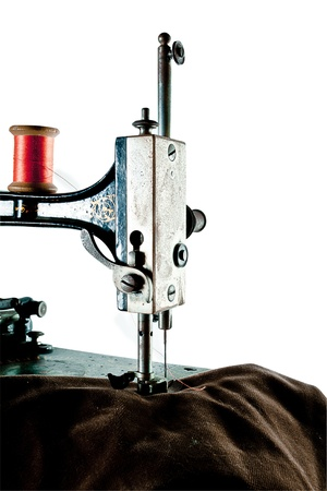 bespoke: Detail of very old sewing machine isolated against white background  Stock Photo