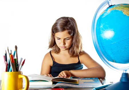 boffin: Little girl finishing her summer homework before going back to school. Isolated on white background with plenty of copyspace. Stock Photo