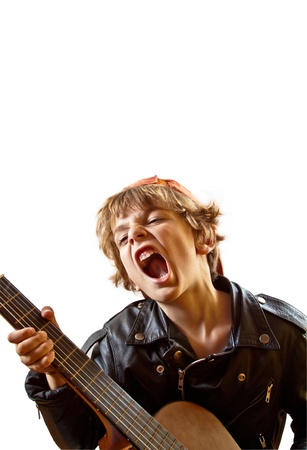 boy playing guitar: Cute small kid playing guitar with great concentration and attitude  White background, plenty of copyspace  Portrait orientation
