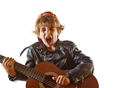 lead guitar: Cute small kid playing guitar with great concentration and attitude. White background, plenty of copyspace. Stock Photo