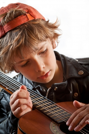 Kid playing guitar  photo