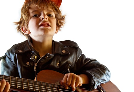 acting: Kid rehearsing to be a bad-ass rock star  Stock Photo