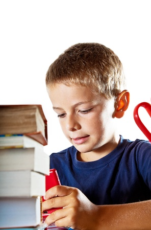 boffin: A little boy at work on his homework on his tablet computer, getting ready to go back to school  Isolated on white background with plenty of copyspace